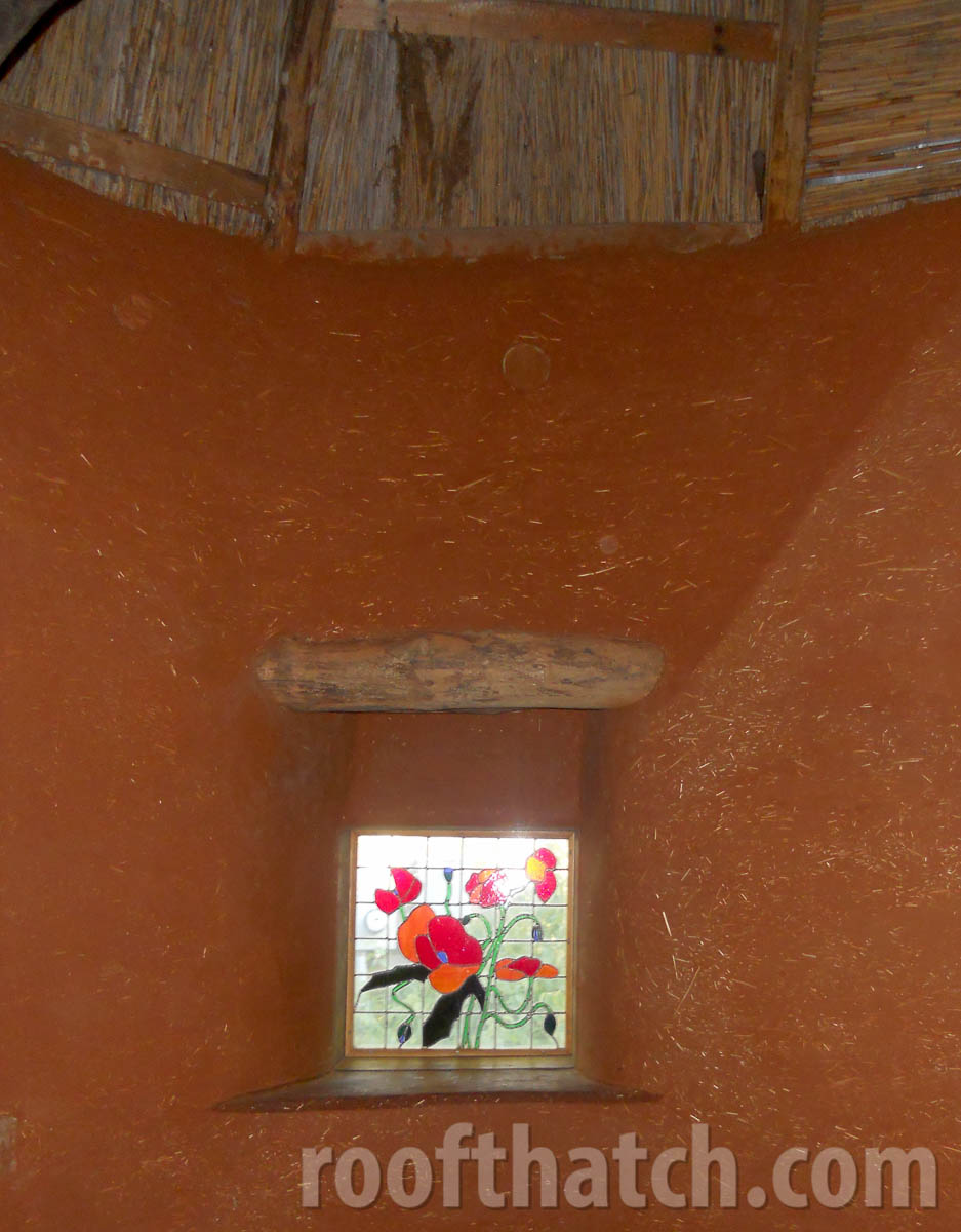 Cob Thatch Interior, Natural Plaster with Copper Finish and Stained Glass Window