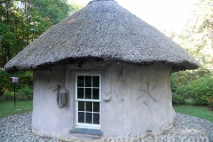 Cob Building Thatched with Character for Water at MoonTree Community, IN