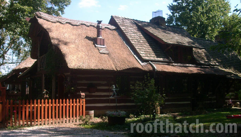 Thatch Eyebrow and Curved Gable End Feature on Log Cabin