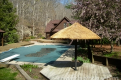 Custom Thatch Umbrella by Deck and Pool