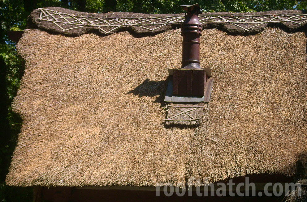 Whimsical Thatched Chimeny Feature
