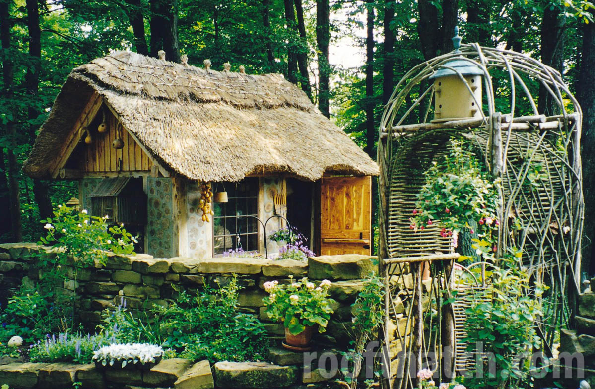 Whimsical Cordwood Thatched Potting Shed next to Trellis